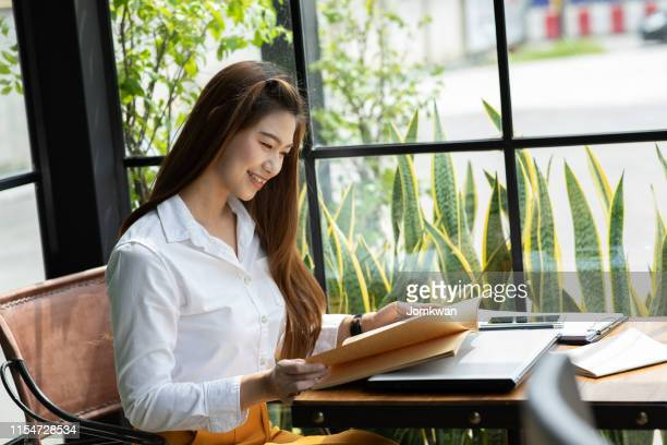 beautiful attractive asian woman reading book