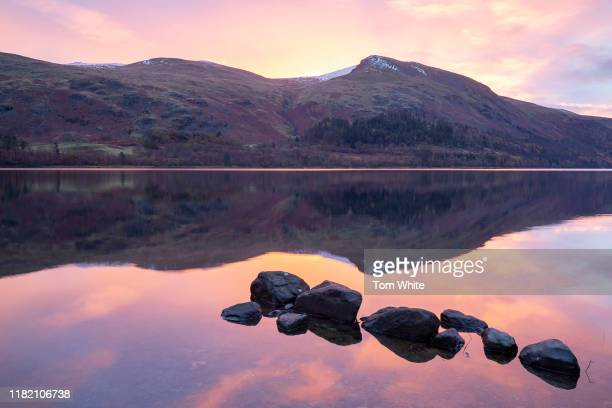 A beautiful autumn sunrise is reflected in Thirlmere in the Lake District on November 13 2019 in Ambleside England Temperatures continue to drop...