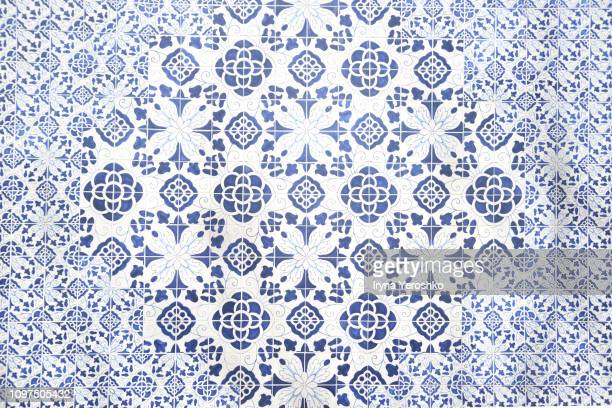 beautiful azulejo blue and white pattern - ceramic stock photos and pictures