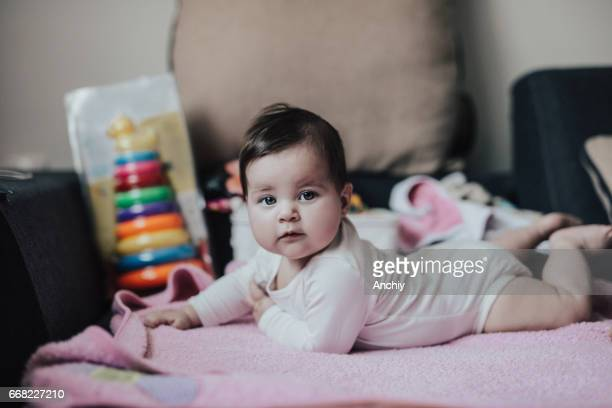 beautiful baby girl on pink blanket - happy new month stock photos and pictures