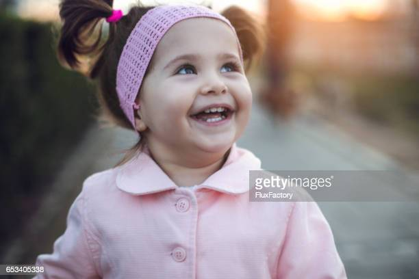 Beautiful baby girl with toothy smile