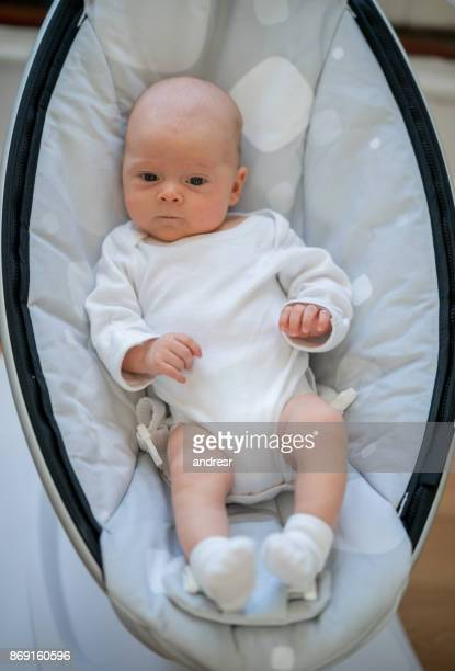Beautiful baby lying on a bouncer