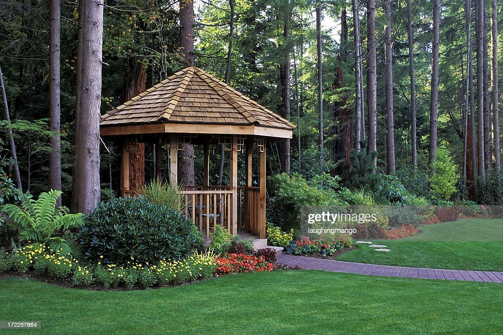 A Beautiful Backyard Garden With Cedar Wood Gazebo Stock Photo