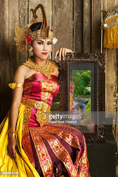 Beautiful Balinese lady with a picture frame