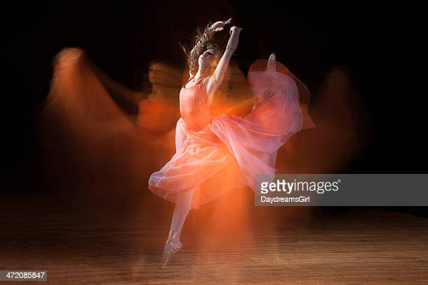 beautiful ballerina dancing on dark stage with ghosts - uitvoerende kunst voorstelling stockfoto's en -beelden