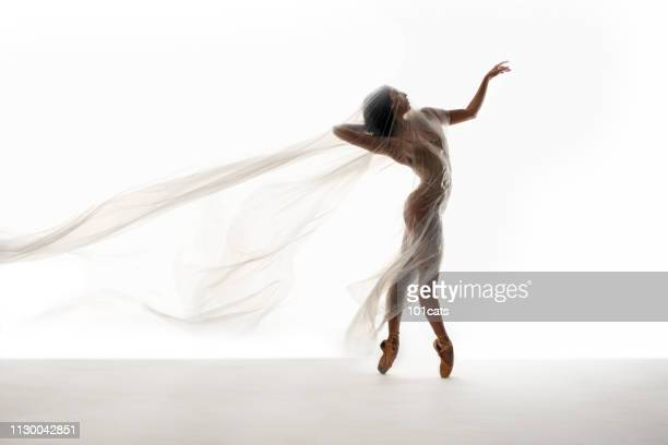 beautiful ballerina dancing with transparent thin nylon - nylon feet stock photos and pictures