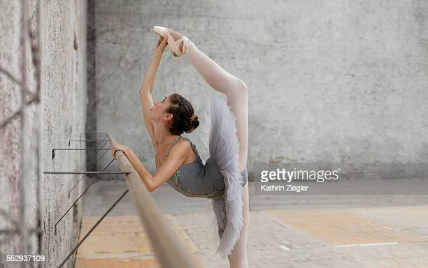 beautiful ballerina practicing at the barre