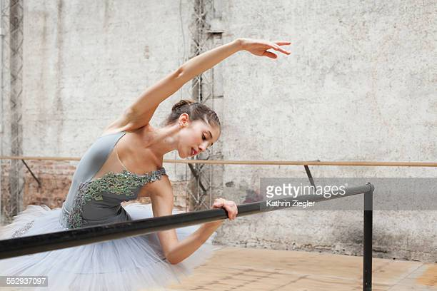beautiful ballerina practicing in rehearsal room - ballet dancer stock pictures, royalty-free photos & images
