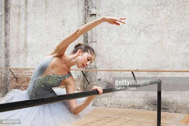 beautiful ballerina practicing in rehearsal room