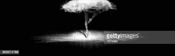 Beautiful ballet dancer, dancing with face powder on stage