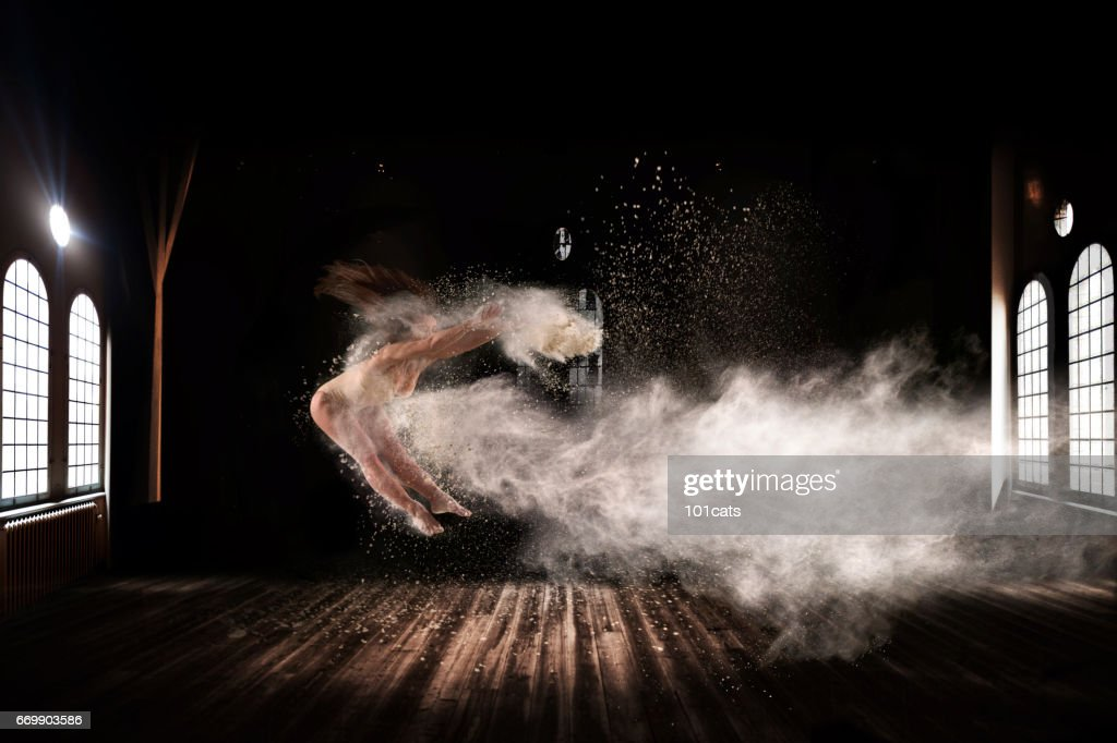 Beautiful ballet dancer, dancing with powder on stage : Stock Photo