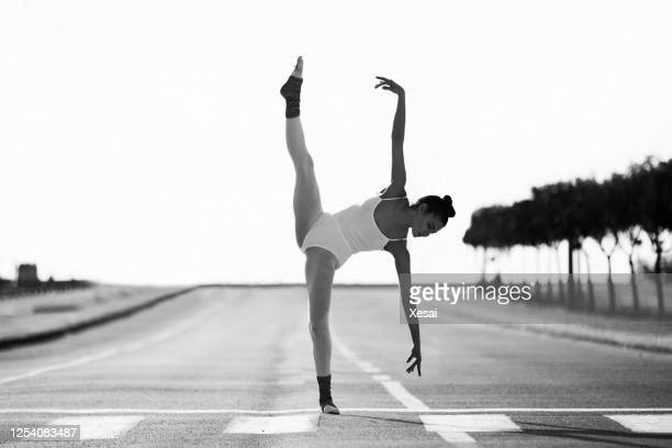 beautiful ballet dancer posing at street - tulle netting stock pictures, royalty-free photos & images