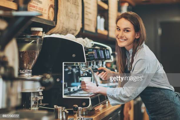 Beautiful barista making espresso