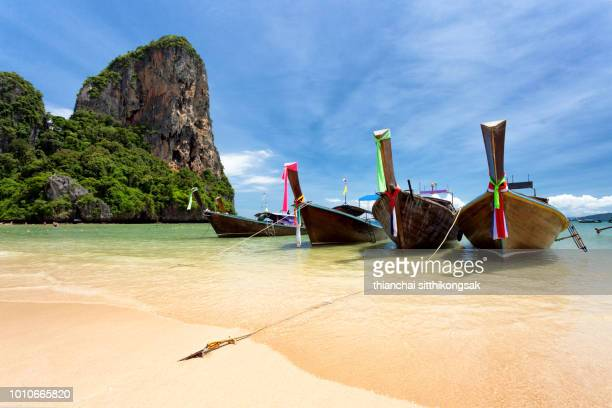 beautiful beach and fisherman boat parked - phuket province stock pictures, royalty-free photos & images