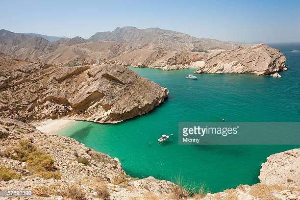 beautiful beach arabian lagoon oman - oman stock pictures, royalty-free photos & images