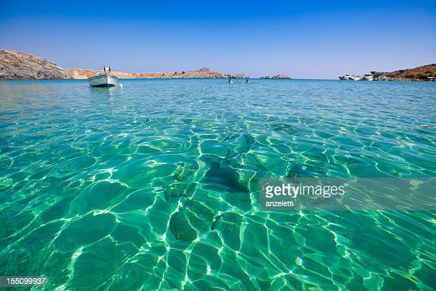beautiful beach in greece - lindos stock photos and pictures