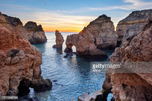 beautiful beach near lagos in ponta da piedade, algarve region, portugal. amazing landscape at sunrise. - traditionally portuguese stock pictures, royalty-free photos & images