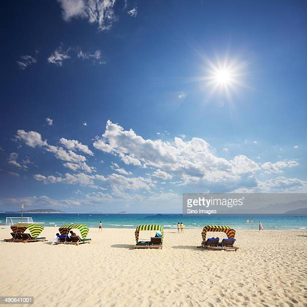 Beautiful Beach Under Blue Sky And White Clouds