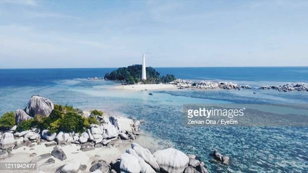 beautiful beach. view of nice tropical beach rock, sand and sky background - 防波堤 ストックフォトと画像