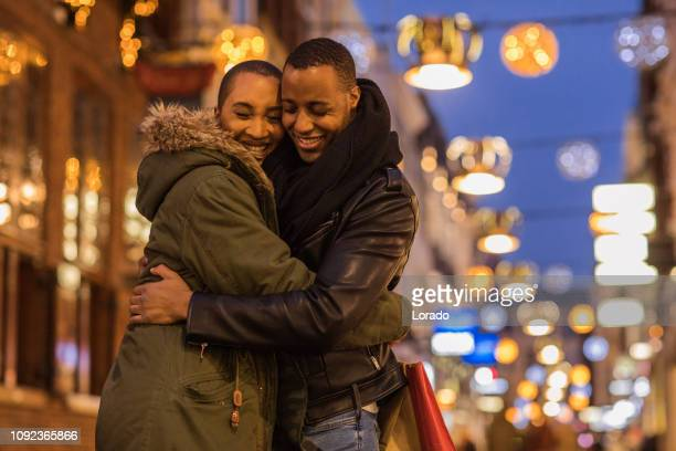 beautiful black couple at christmas shopping - hague market stock pictures, royalty-free photos & images