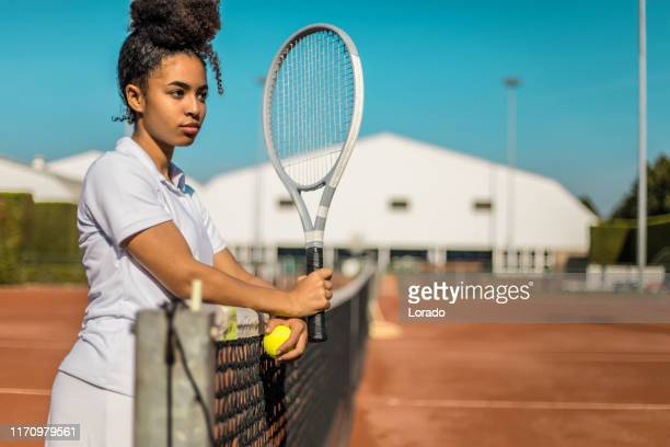 a beautiful black female tennis player on the court - torneo di tennis foto e immagini stock