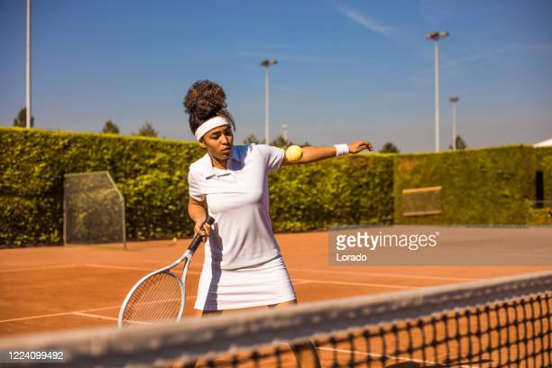 a beautiful black female tennis player on the court - international match stock pictures, royalty-free photos & images