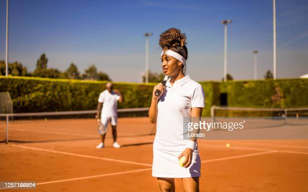 a beautiful black female tennis player on the court with her coach father - international match stock pictures, royalty-free photos & images