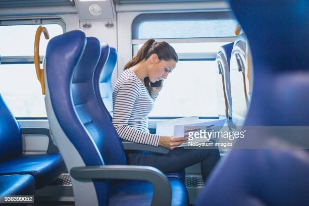 beautiful black hair woman, traveling by the train - train interior stock photos and pictures
