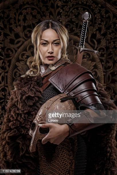 beautiful black sword wielding viking warrior female - royal person stock pictures, royalty-free photos & images
