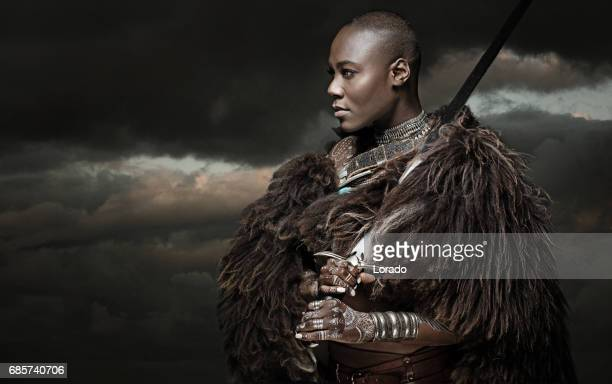 beautiful black warrior princess holding a sword in studio shot - barbarian stock photos and pictures