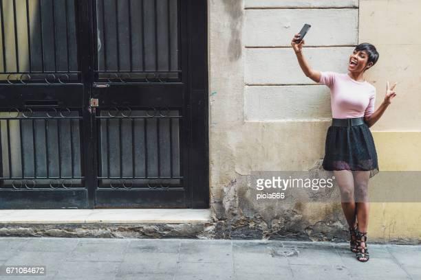 Beautiful black woman portrait: taking a selfie