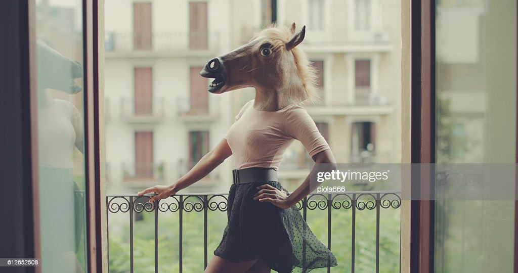 Beautiful black woman portrait with horse head : Stock Photo