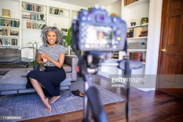 beautiful black woman recording a video - influencer stock pictures, royalty-free photos & images