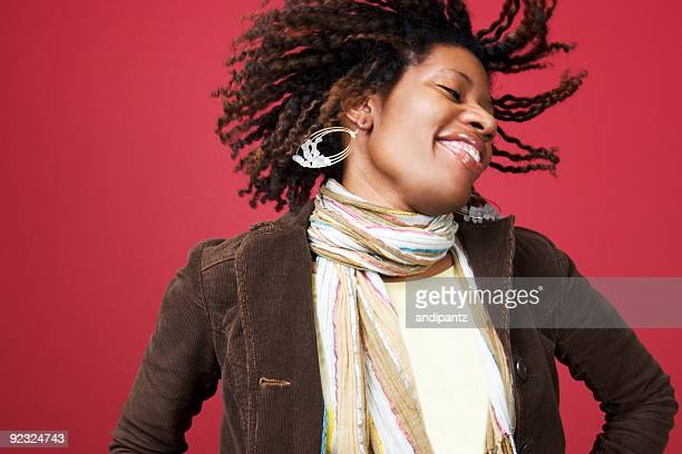 Beautiful black woman shaking her head with flying hair