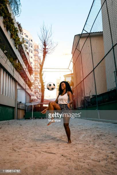beautiful black young girl showing skill with a soccer ball - ambassador stock pictures, royalty-free photos & images