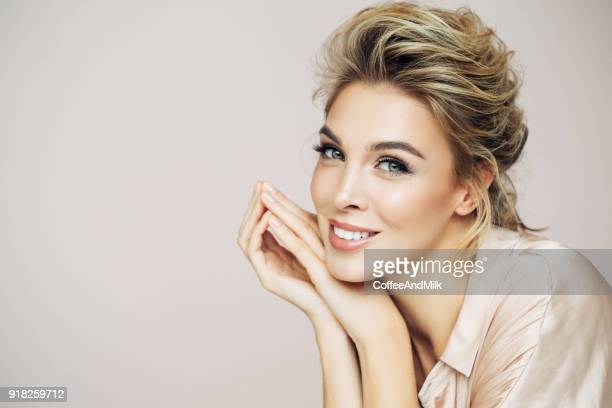 beautiful blond with perfect smile - stage make up stock photos and pictures