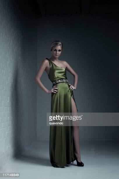 beautiful blond young woman fashion model in evening gown - satin dress stock photos and pictures