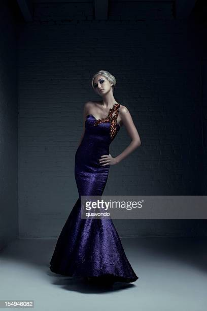 beautiful blond young woman fashion model in evening gown - purple dress stock pictures, royalty-free photos & images