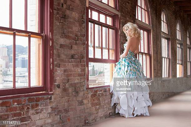 Beautiful Young Woman Fashion Model, Paper Gown, Standing at Windo