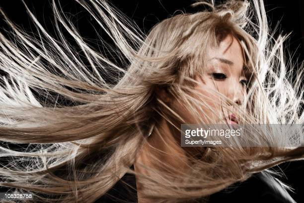 Beautiful Blonde Asian Woman With Long Blowing Hair