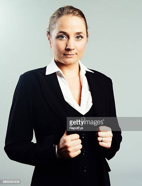 beautiful blonde businesswoman looks serious, confident and challenging - lapel stock pictures, royalty-free photos & images