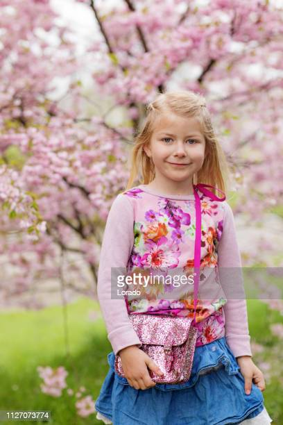 beautiful blonde dutch child daughter in a cherry blossom forest - northern europe stock pictures, royalty-free photos & images