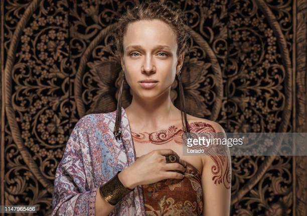 beautiful blonde ethnic woman wearing henna tattoo - royal person stock pictures, royalty-free photos & images