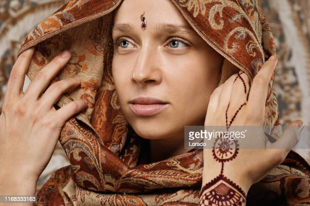beautiful blonde ethnic woman wearing henna tattoo - head of state stock pictures, royalty-free photos & images