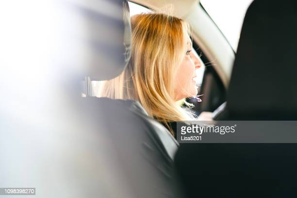 beautiful blonde female driver, 60 years old - 55 59 years stock pictures, royalty-free photos & images