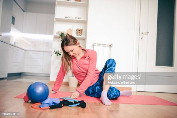 beautiful blonde female exercising yoga in the morning at home - aleksandar georgiev stock photos and pictures