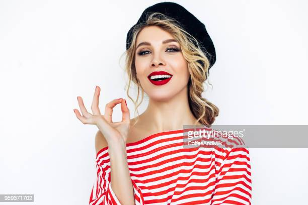 beautiful blonde french woman wearing red beret - frança imagens e fotografias de stock