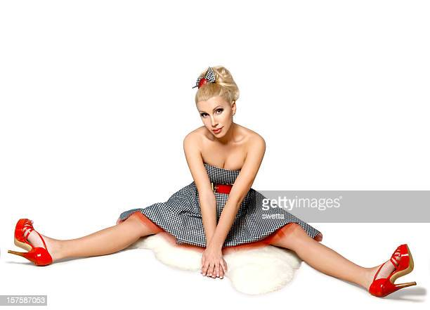 beautiful blonde in a short dress - bow legs stock photos and pictures