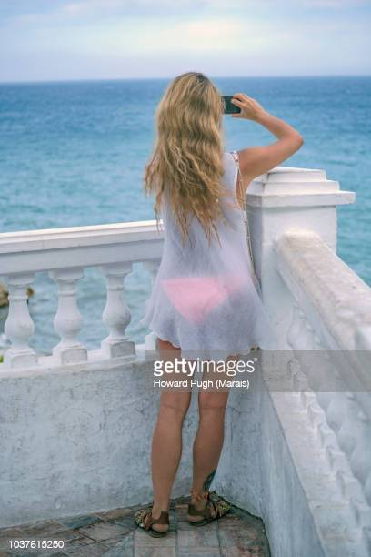Beautiful blonde in a White Toga. Mediterranean Coastline