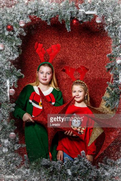 beautiful blonde sisters at christmas - 6 11 months stock pictures, royalty-free photos & images